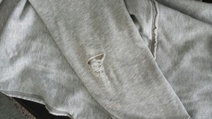 My favorite sweatshirt with a hole in the elbow.  Sad day.  :(