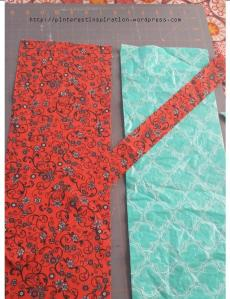 My material is cut and ready for the next step.  The red material is for the outside, and the teal is a piece of plastic tablecloth.